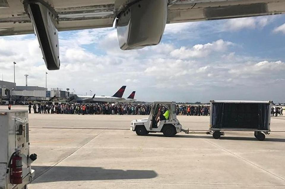 "Photo courtesy of Taylor Elenburg shows Passengers gathering on the tarmac of the Fort Lauderdale-Hollywood airport in Florida after a gunman opened fire on January 06, 2017. A gunman opened fire Friday at Fort Lauderdale-Hollywood airport in Florida, causing multiple fatalities, officials said. ""Confirmed: Shooting at Fort Lauderdale-Hollywood International Airport with multiple people dead. One subject in custody,"" the Broward County Sheriff's office said in a tweet. Mayor Barbara Sharief said there was one shooter who was now in custody. She said the motive for the attack was not yet known. / AFP PHOTO / COURTESY OF TAYLOR ELENBURG / Taylor ELENBURG / XGTY RESTRICTED TO EDITORIAL USE DISTRIBUTED AS A SERVICE TO CLIENTS COURTESY Of TAYLOR ELENBURG TAYLOR ELENBURG/AFP/Getty Images"